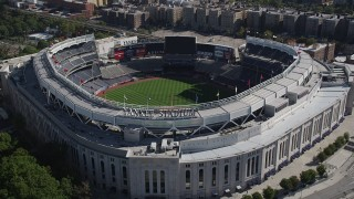 AX91_019 - 4K stock footage aerial video of approaching Yankee Stadium, tilting to baseball field, The Bronx, New York