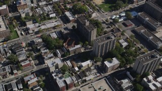 AX91_022 - 4K stock footage aerial video of a bird's eye view of apartment buildings and row houses in The Bronx, New York, New York