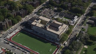 AX91_024 - 4K stock footage aerial video approach Christopher Columbus High School and tilt to a bird's eye view of the building, The Bronx, New York