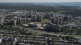 AX91_025 - 4K stock footage aerial video of approaching Harry S. Truman High School and Co-op City apartment buildings, The Bronx, New York