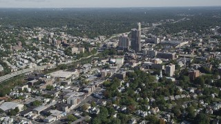 AX91_030 - 4K stock footage aerial video of flying by shops and office buildings, New Rochelle, New York