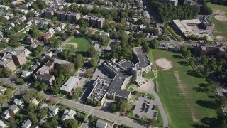 AX91_031 - 4K stock footage aerial video of flying over suburban neighborhoods, Isaac E. Young Middle School, New Rochelle, New York