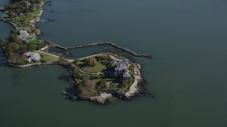 AX91_033 - 4K aerial stock footage video approach and tilt to an island mansion in New Rochelle, New York