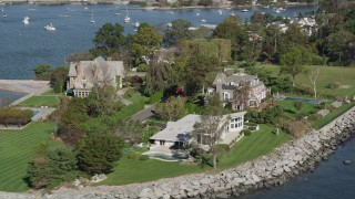 AX91_037 - 4K stock footage aerial video of flying by oceanfront mansions, Mamaroneck, New York