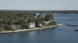 AX91_038 - 4K stock footage aerial video of passing by oceanfront mansions, Mamaroneck, New York