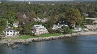 AX91_039 - 4K stock footage aerial video of flying by ocean and beachfront mansions, Mamaroneck, New York