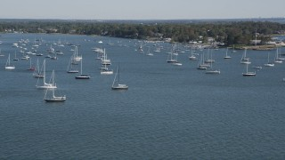 AX91_040 - 4K stock footage aerial video of tilting from the ocean to reveal sailboats near the coast, Rye, New York