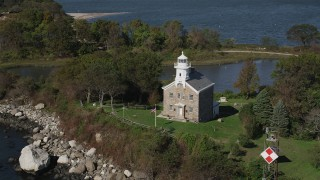 AX91_058 - 4K stock footage aerial video of orbiting lighthouse on Great Captain Island, Greenwich, Connecticut