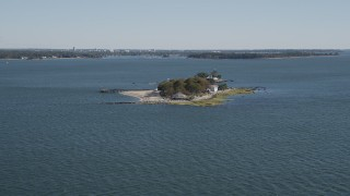 AX91_059 - 4K aerial stock footage video of approaching an oceanfront, island home, Island Beach, Connecticut