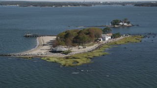 AX91_060 - 4K stock footage aerial video of flying by a small island home, Island Beach, Connecticut