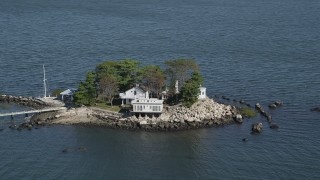 AX91_061 - 4K stock footage aerial video of passing an isolated island home, Island Beach, Connecticut