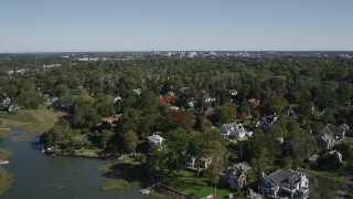 AX91_067 - 4K stock footage aerial video of flying over oceanfront homes, suburban neighborhoods, Greenwich, Connecticut