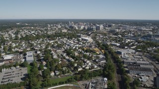 AX91_071 - 4K stock footage aerial video of following railroad tracks to approach Downtown Stamford, Connecticut