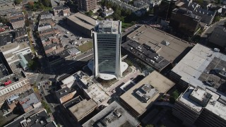 AX91_077 - 4K stock footage aerial video of approaching an office building, tilt to bird's eye view in Downtown Stamford, Connecticut