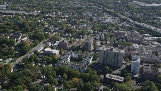 AX91_078 - 4K stock footage aerial video of flying by apartment buildings and suburban homes, Stamford, Connecticut