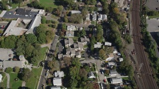 AX91_080 - 4K stock footage aerial video approach suburban homes by railroad tracks, Stamford, Connecticut