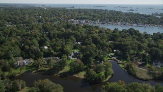 AX91_089 - 4K stock footage aerial video of flying over riverfront mansions and trees toward Five Mile River, Norwalk, Connecticut