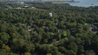 AX91_093 - 4K stock footage aerial video of flying over trees and suburban homes in Norwalk, Connecticut