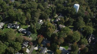 AX91_094 - 4K stock footage aerial video of tilting to suburban homes and neighborhoods with trees in Norwalk, Connecticut