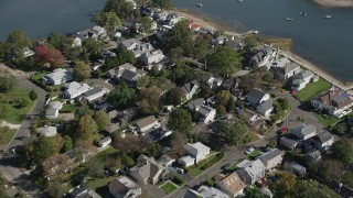 AX91_097 - 4K stock footage aerial video of flying over waterfront homes in Norwalk, Connecticut