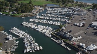 AX91_098 - 4K stock footage aerial video tilt from the water to reveal Norwalk Cove Marina, Norwalk, Connecticut