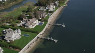 AX91_100 - 4K stock footage aerial video of flying by ocean and beachfront homes with docks, Norwalk, Connecticut