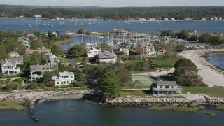 AX91_102 - 4K stock footage aerial video of flying by beachfront homes and marina in Westport, Connecticut