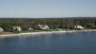 AX91_107 - 4K stock footage aerial video of flying by beachfront mansions on the shore, Westport, Connecticut
