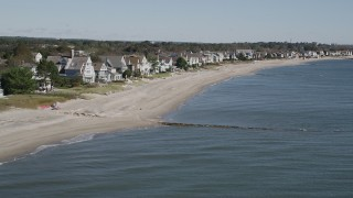 AX91_112 - 4K stock footage aerial video of flying by a row of homes lining a beach in Fairfield, Connecticut