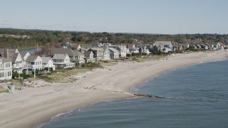 AX91_113 - 4K stock footage aerial video of passing by a row of beachfront homes, Fairfield, Connecticut