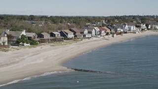 AX91_114 - 4K stock footage aerial video of flying by a row of beachfront homes, Fairfield, Connecticut