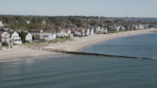 AX91_115 - 4K stock footage aerial video of flying by a row of beachfront homes, Fairfield, Connecticut