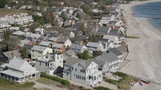 AX91_117 - 4K stock footage aerial video of flying by homes on the beach in Fairfield, Connecticut