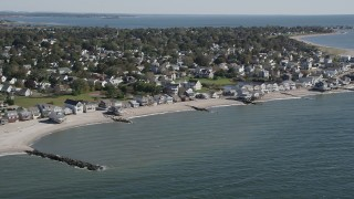 AX91_120 - 4K stock footage aerial video of flying by beachfront homes in a coastal neighborhood in Stratford, Connecticut