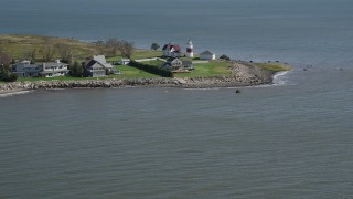 AX91_122 - 4K stock footage aerial video of tilting up from the water, revealing Stratford Point Light in Stratford, Connecticut
