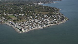 AX91_127 - 4K aerial stock footage video of approaching beachfront homes in Milford, Connecticut