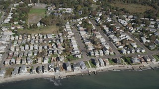 AX91_128 - 4K stock footage aerial video of passing beachfront homes in Milford, Connecticut