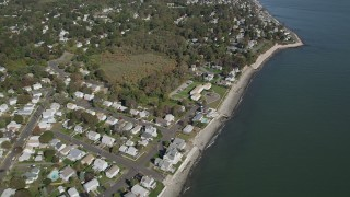 AX91_129 - 4K stock footage aerial video of flying by homes near the beach in Milford, Connecticut