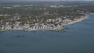 AX91_130 - 4K stock footage aerial video of flying by neighborhoods near the beach in Milford, Connecticut