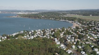 AX91_132 - 4K stock footage aerial video of flying by beachfront homes on Morris Cove, New Haven, Connecticut