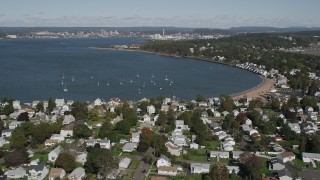 AX91_133 - 4K stock footage aerial video of flying by beachfront homes beside Morris Cove, New Haven, Connecticut