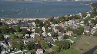 AX91_134 - 4K stock footage aerial video of flying by homes near the beach and Morris Cove, New Haven, Connecticut