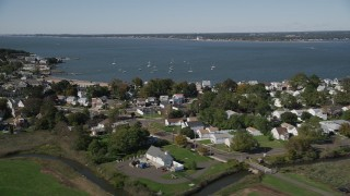 AX91_135 - 4K stock footage aerial video of flying by homes and Morris Cove, New Haven, Connecticut