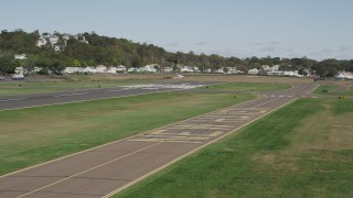 AX91_137 - 4K stock footage aerial video of flying by runways at Tweed New Haven Regional Airport, New Haven, Connecticut