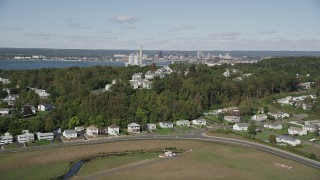 AX91_138 - 4K stock footage aerial video of flying by suburban homes on a small hill in New Haven, Connecticut