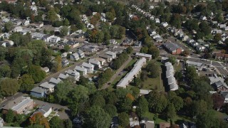 AX91_139 - 4K stock footage aerial video of flying over suburban homes in autumn, New Haven, Connecticut