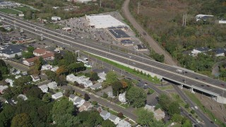AX91_140 - 4K stock footage aerial video fly over suburban homes, pan across Connecticut Turnpike freeway, New Haven, Connecticut