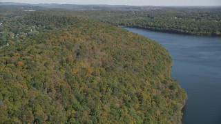 AX91_143 - 4K stock footage aerial video of approaching forests on the shore, autumn, Lake Saltonstall, Connecticut