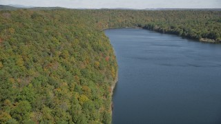 AX91_145 - 4K stock footage aerial video of flying over forests in autumn and Lake Saltonstall, Connecticut