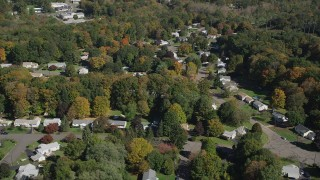 AX91_151 - 4K stock footage aerial video of flying by suburban neighborhoods, autumn, East Haven, Connecticut